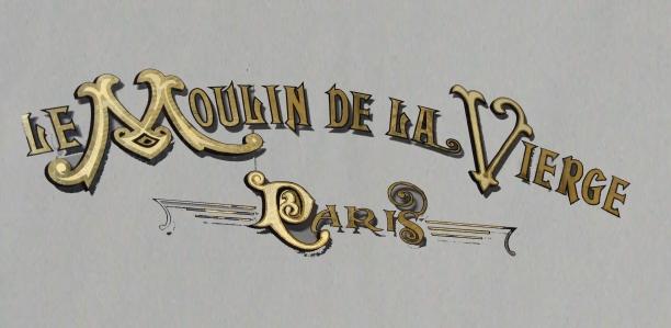 """Logo sur vitrine de l'Ancienne boulangerie """"Le Moulin de la Vierge"""""""