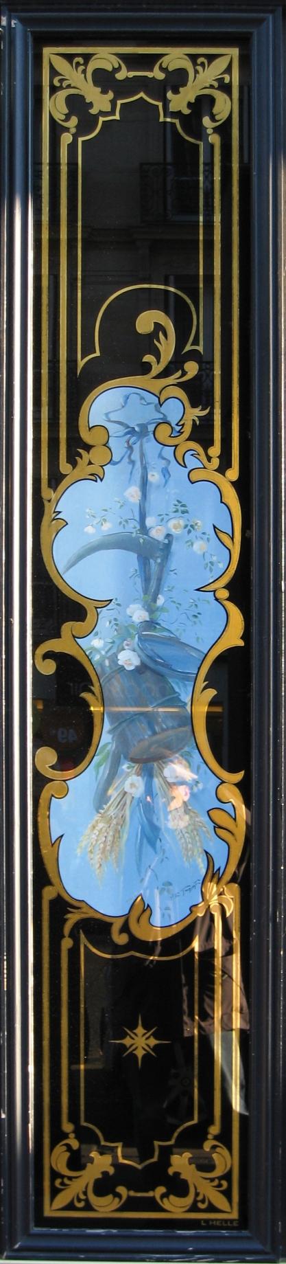 """Boulangerie 81 rue de Rennes Paris : Panneau décoratif avec toile peinte """"faux sur fond bleu"""""""